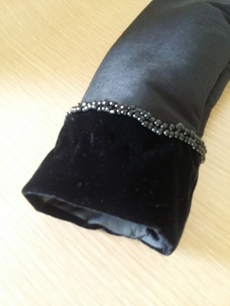 Beading on one of the cuffs