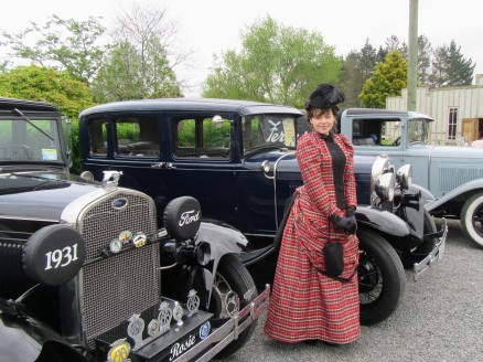 With the vintage cars