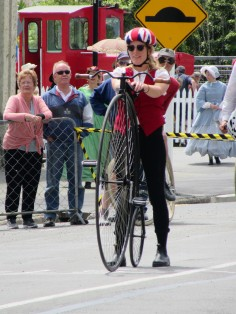 Krista, visiting from the USA, learned how to ride a penny farthing the day before the race