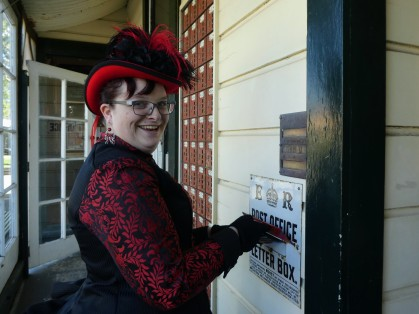 Maree posting her postcard