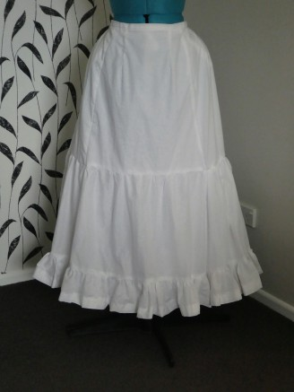 Worn over hip pad and another petticoat
