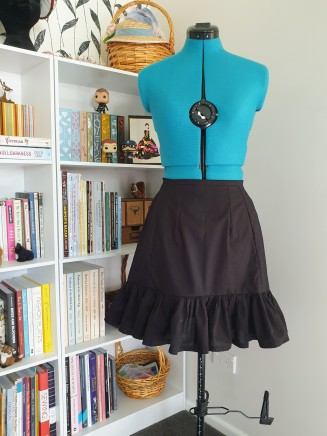 Petticoat in black, which makes more sense really...